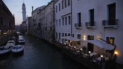 WS HA LD Boats Moored in Canal Next to Cafe at Night / Venice, Italy Stock Footage