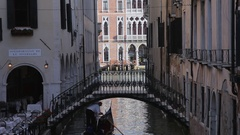 WS LD Gondola Going under Bridge / Venice, Italy Stock Footage