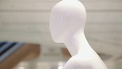 Mannequin or dressmakers dummy on with shopping mall on background Stock Footage