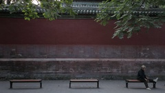 TD MS Elderly men and woman sitting in front of red wall / Beijing, China Stock Footage