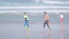 Happy surfer friends at the beach in ultra hd format Stock Footage