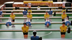 Father and child play kicker table football soccer Stock Footage