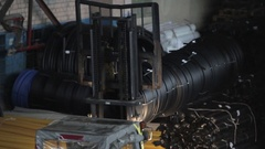 Loader puts coil pipes on stock Stock Footage