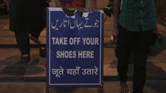 MH LD Sign Asking to Take Off Shoes / Jama Masjid Mosque, India Stock Footage
