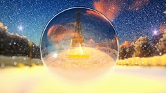 Eiffel Tower seen through a glass orb, winter holidays background Stock Footage