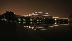 WS PAN Great Hall of the People next to National Grand Theater reflecting at Stock Footage