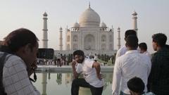 WS People Posing in front of Taj Mahal / Agra, India Stock Footage