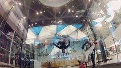 Skydivers flying inside fly station. Training. Extreme sport. Holding balance Stock Footage