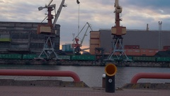 View of cargo port at seafront. River. Working crane. Containers. Summer evening Stock Footage