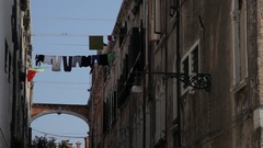 MH LA LD Laundry Hanging out to Dry Between Buildings / Venice, Italy Stock Footage