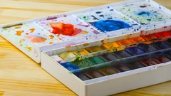 Set of watercolor paints and paint brushes Stock Footage