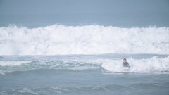 Pro Surfers Riding Waves Stock Footage