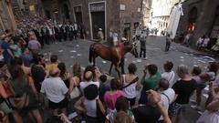 WS HA PAN Crowd Following Winning Horse of Palio down Street / Siena, Italy Stock Footage