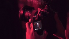 Shoots stage and silhouettes of people by phone 4k Stock Footage
