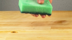 Sponge for washing dishes and cleaning agent Stock Footage