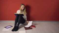 Persistent Young Student Girl Studying on Floor Stock Footage