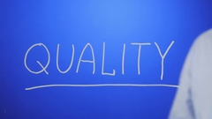 Erase the word QUALITY Stock Footage