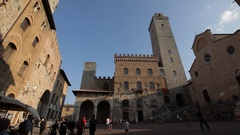 WS LA LD People Walking Through San Gimignano Piazza / Tuscany, Italy Stock Footage