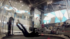 Skydivers flying into fly station. Training. Extreme sport. Holding balance Stock Footage