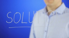 Erase the word SOLUTIONS Stock Footage
