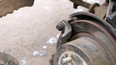 Auto mechanic working on brakes in car repair shop Stock Footage