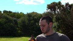 Wonthaggi, Australia: Boy Drinks Glass Bottle, Satisfied Stock Footage