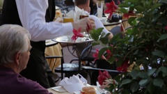 MH TD Waiter Serving Drinks to People in Cafe in Piazza Della Signoria / Stock Footage