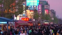Wangfujing shopping street at dusk, Beijing, China Stock Footage