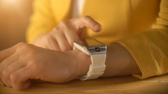 Woman's hand touching the screen of a smart watch Stock Footage