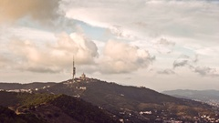 Timelapse of clouds passing over mount Tibidabo, in Barcelona, Spain. Stock Footage
