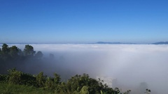 Fog in the morning with mountain and blue sky at Khao Kho, Phetchabun, Thailand Stock Footage