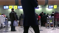 Airport Passengers Check In At Ticket Counter. People In Airport Terminal Stock Footage