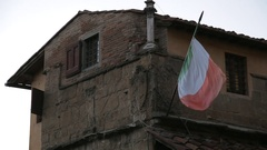 MH LA LD Italian Flag Waving Outside Old Building / Florence, Italy Stock Footage