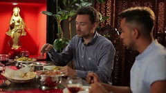 Two men dining at the restaurant Stock Footage