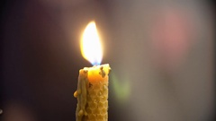 Candle Burns in The Church. 4K Stock Footage