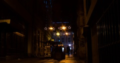 Street alley at night. Decorations. People and cars passing by. 24fps PNG 4k Stock Footage