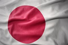 Waving colorful flag of japan. Stock Photos