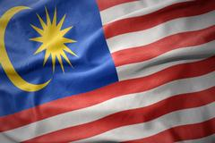 Waving colorful flag of malaysia. Stock Photos