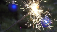 Bengal light against the background of a Christmas tree with New Year's balls Stock Footage
