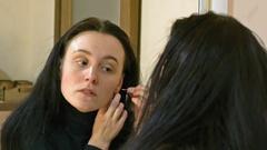 Beautiful long hair brunette woman wears earrings Stock Footage
