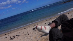 Wonthaggi, Australia: Person with broken leg looks at the ocean Stock Footage