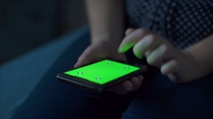 Female hands using cell phone with green screen Stock Footage