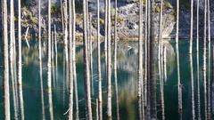 Kaindy Lake Flooded Forest Autumn Mountains Reflection Season 4K Stock Footage