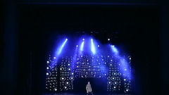 Young dancer dancing hip-hop on the stage with bright light.  Stage Light. Arkistovideo
