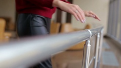 Close-up hands of a young girl holding the handrail  in the spacious hall. Stock Footage