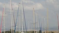 The tops of masts of yachts at the pier in the port of Acre Stock Footage