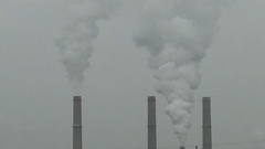 Industrial chimneys with white fog Stock Footage