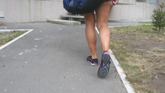 Strong female legs in sport shoes going on stairs up to gym to training Stock Footage