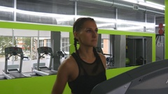 Girl exercising during cardio workout. Female training indoor at sport club. Stock Footage