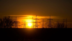 High-voltage power lines at sunset Stock Footage